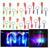 Wholesale 100Pcs Amazing LED Light Arrow Rocket Helicopter rotating Flying Toy Party Fun Gift Blue light Children s toys