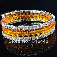 Las pulseras esqueléticas de los brazaletes de los encantos de los Rhinestones checos cristalinos anaranjados de 12pcs 3rows venden al por mayor la joyería A-710 de la manera
