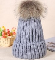 Wholesale European models super raccoon hair ball ladies wool hat Korean version of the ear thicker warm knit hat