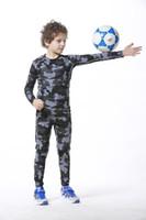 Precio de Capas base-Compression Kids Basketball Running T Shirts Niños de la base de la capa de engranaje de medias Jersey de béisbol Niños camisas de deportes de largo