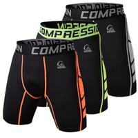 Pantalones cortos de compresión de los hombres al por mayor-Pantalones de la capa base de las medias que funcionan al aire libre