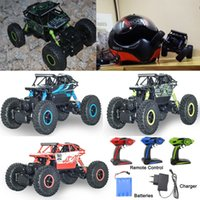 Wholesale New remote control GHz rock x4 double motors bigfoot off road vehicles crawlers rally climbing car children adult toys