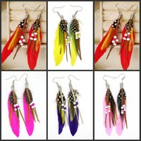 beach photo albums - Women s long feather earrings ear ornaments Bohemian wind beach resort photo albums essential accessories
