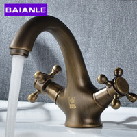 Wholesale Golden Brass Double handle Bathroom Basin Faucet Hot And Cold Water Sink Faucet Bath Accessories