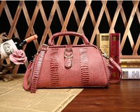 Wholesale 2016 new fashion leather handbags brand Korea first layer of leather hand Messenger Messenger bag