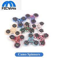 Nouveaux couleurs adorables Camo Hand Spinner 8 couleurs Matériau ABS avec métal Tri Bar Fidget Finger Spinners Dépresseur Jouets Focus Toy