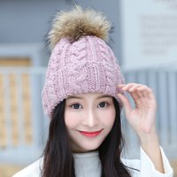 Wholesale Hat female hair ball knitted hat warm winter large raccoon silver fox curling hair ball really pure Korean family cap