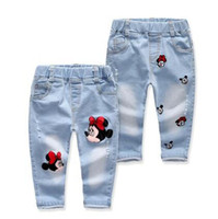 Wholesale baby holes jeans children denim pants jeans for girls cartoon animals print casual wear kids clothes