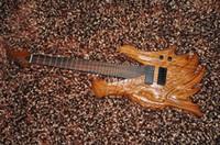 7 cordes guitare électrique Corps sculpté Chine dragon design mis en cou EMG micros en stock expédition gratuite