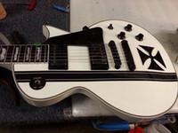 Wholesale Rare LTD James Hetfield Metallic Iron Cross Classic White Black Electric Guitar V Battery Box Active EMG Pickups Black Hardware