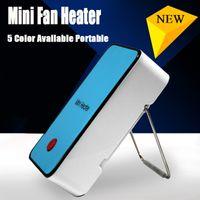 Wholesale Portable Mini fan heater hand Electric Air Warmer Heating Winter Keep Warm Desk Fan for Office Home