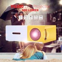 Venta al por mayor-Venta caliente YG300 / YG310 LCD proyector del proyector de los medios 600LM MINI proyector video juegos TV Home Theat ayuda HDMI AV SD