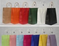 Cheap Multi color 2000pcs kraft paper gift bag With Handles for shopping Christmas Festival package size 27*21*11cm Z741
