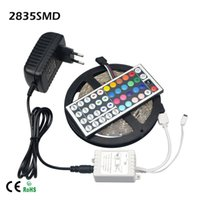 al por mayor fuente de alimentación de 12v para leds-IP65 / IIP20 RGB 3528 los 5M 300 Leds WW / CW / R / G / B / Y llevó la iluminación de tira ligera impermeable 44 llaves IR teledirigido + 12V 2A fuente de alimentación + enchufe