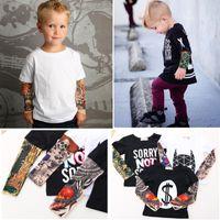 Mode Streetwear Vêtements pour enfants 2017 Printemps manches longues avec fausse tatouage Impression hip hop garçons T-shirts filles Tees Shirts Tops