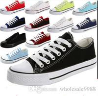 2015 продажа горячего низкой Стиль звезды спорта свободная перевозка груза Патрон холстины для обуви Кроссовки мужские / женские Холст обувь