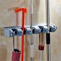 Wholesale New ABS Plastic Position Kitchen Organizer Wall Shelf Mounted Hanger Mop Brush Broom Organizer Storage Holder