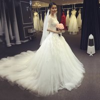 Wholesale 2017 new Korean wedding dress wedding dress bride long tail tail five pointed sleeve thin shoulder thin delicate lace decals