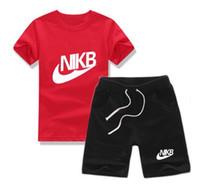 großhandel jogging suit-2017 Sommer Markenkindkleidung stellte Jungensportklagekind Kurzhülse T-Shirt + Kurzschlüsse Hosemädchen ein, die den Jogging Trainingsanzug kleiden