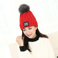 Wholesale autumn and winter new wool cap letters IGE Ms curling bonnets hats fashion hair ball winter knit hat for girl