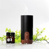 Wholesale Cylindrical Car Aroma Diffuser with three colors Air Humidifier Purifier used in car GX B02 Aromatherapy Machine