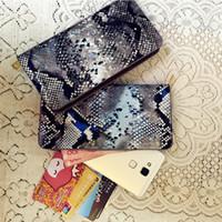 Liquidación a la venta Serpentina Vintage mujer carteras bolso de embrague Tarjeta de crédito paquete de marca señoras bolso largo estilo de Inglaterra VKP1218D