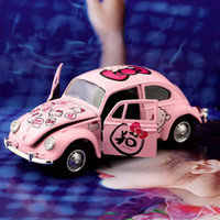 Wholesale KT cartoon cat alloy model children toy car decoration dolls perfume base