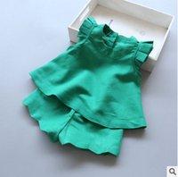 Precio de Líneas blancas-Los muchachos de la princesa de las muchachas 2017 nuevos niños del verano vuelan la manga A-Line camisa + pantalones cortos 2pcs fija la ropa de los cabritos T1777 verde blanco azul rosado