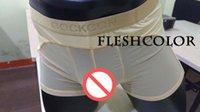 al por mayor pantalones de los hombres de la ropa interior-La ropa interior de los hombres de la marea Los pantalones de los hombres de seda transparentes convexos del hielo de los pantalones de los pantalones bajos de la cintura de los pantalones cortos atractivos masculinos de los hombres de la marea