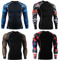 Precio de Capas base-Las camisas de la compresión de los hombres atormentan las mangas largas termales de la camiseta bajo desgaste superior del levantamiento de pesas de la capa de la aptitud basan el envío libre