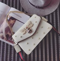 Women bee pearls - factory brand handbag lovely Rhinestone chain bag elegant woman bee pearl decorative leather shoulder bag women bag small fresh pearl spring