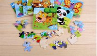 Wholesale The Hot Wooden pieces of cartoon puzzle baby early lessons intelligence toys for children