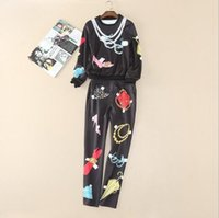 Wholesale Europe and the United States women s clothing in the spring of the new necklace printing drills very long fleece pants suit