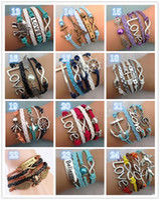 Bohemian antique brass lobster clasps - Leather Bracelet Antique Cross Anchor Love Peach Heart Owl Bird Believe Pearl Knitting Bronze Charm Bracelets colors TA134