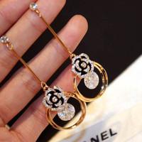 Wholesale hot selling fashion earring jewelry titanium steel k rose gold zircon diamond glittering tassel exquisite Camellia earrings jewelry