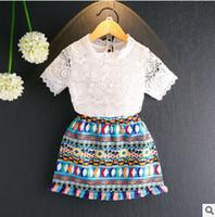 Precio de Faldas para las muchachas de los niños-Las muchachas de los muchachos de los muchachos de los trajes del bebé ponen en cortocircuito la falda 2pcs de la borla de la tapa + de la borla del ganchillo de la manga del collar la nueva princesa de los cabritos fija T1956