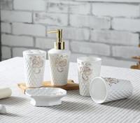 Wholesale Leaf Shape Ceramic Bathroom Accessories Elegant Pieces Bathroom sets soap bottle soap dish toothbrush holder cups white color