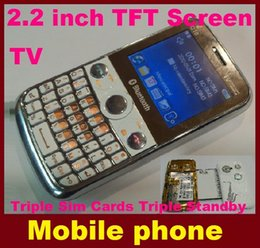 Wholesale cheapest NEW Triple Sim Cards Triple Standby phones TV Media Audio MP3 MP4 phone quad band inch TFT Screen mobile phone Q10 DHL FREE