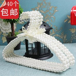 Wholesale cm bathroom products hangers for clothes child plastic wall hanger white slip baby pearl hook clothes rack