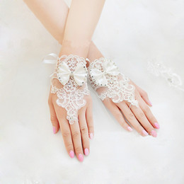 New 2015 Cheap Long Bridal Gloves Lace Appliques Beads Fingerless Wrist Length With Bow Bridal Gloves Wedding Accessories