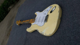 Wholesale The electric guitar ST products milk yellow color restoring ancient ways