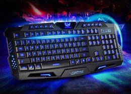 Wholesale HK M200 Gaming Keyboard tri color backlit keyboard keys no conflict Mechanical feeling cf lol USB Desktop PC Keyboards Mice Inputs