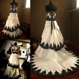 Stunning Gothic Black and White Wedding Dresses 2015 Lace Appliques Cascading Court Train Taffeta Steampunk Halloween Bridal Gowns