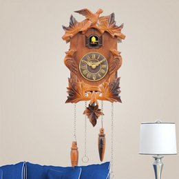 Wholesale China cheap price hot sale home decoration gift solid wood hand carved bird wall clock cuckoo clock