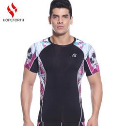 Descuento capas base Venta al por mayor de compresión de camisetas Hombre de manga corta Peso Liftng Fitness base de la capa Bodybuilding medias Correr Camisetas Ropa
