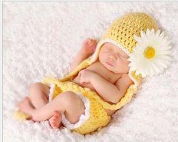 2014Free envío 1 psc lindo infantil del bebé del girasol de punto de vestuario Foto apoyo de la fotografía del recién nacido amarillo desde cute baby accesorios de fotografía fabricantes
