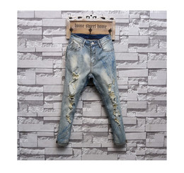 Spring 2016 fashion retro hole pants do old beggar jeans men straight skinny jeans male feet pants