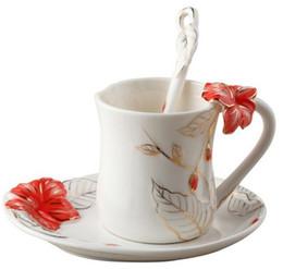 Gros-européenne Céramique Fine Bone China Cup émail Hula Fleur de café Set Creative Tea Cup Set Franc peinture Mode Set, livraison gratuite à partir de thé floraison gros en chine fabricateur