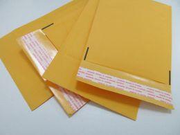 Kraft enveloppe jaune en Ligne-Emballage d'enveloppe d'enveloppe jaune d'enveloppe de haute qualité Emballage Emballage de sachet de bulle en PE Emballage de bulle d'emballage Kraft 160 * 140 + 40mm En stock