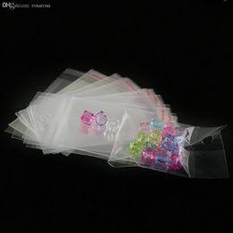 100pcs al por mayor de alta calidad / porción Claro Mini bolsas pequeñas de plástico para la joyería 5 * 10.5cm sello auto-adhesivo OPP paquete bolsa PDC01-01CL desde pequeñas bolsas de plástico adhesivo transparente proveedores